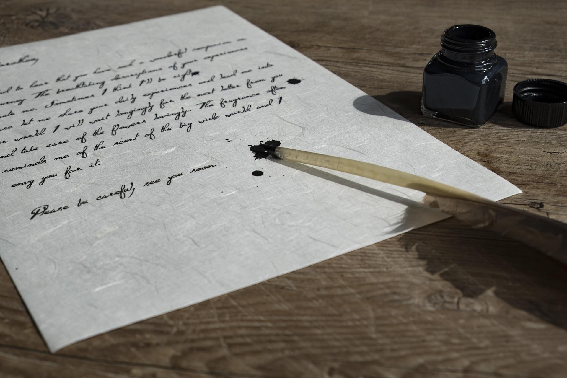 Blatt mit Schreibfeder